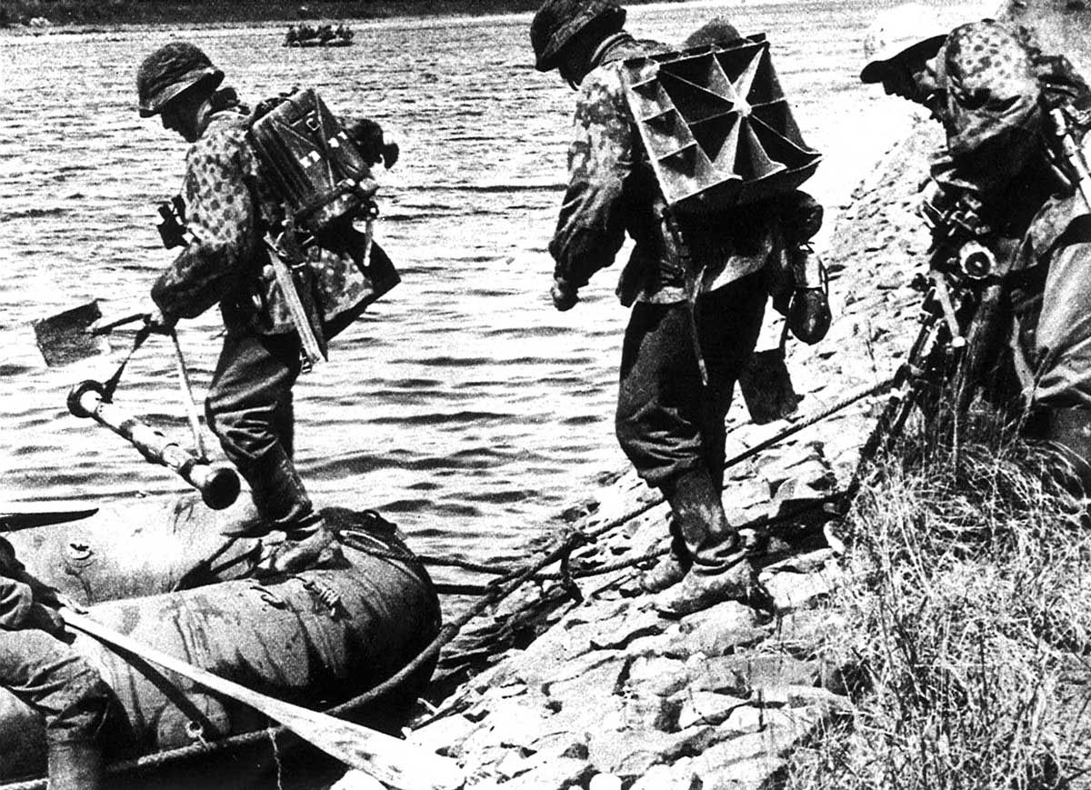 Current Caption: German troops crossing a river in France, 1940