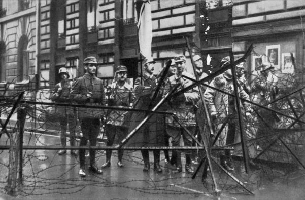 The Munich Putsch. In this photograph are Rudolf Hess (second from left) and Heinrich Himmler (holding flag).