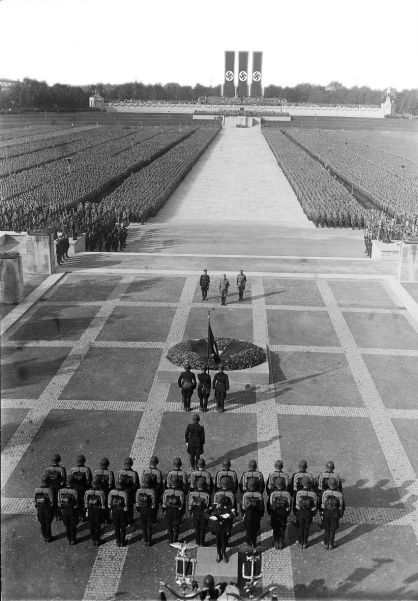 Party Day at Nuremberg, 1934. Beside Hitler stand Himmler (left) and Victor Lutze (right), the new SA commander.