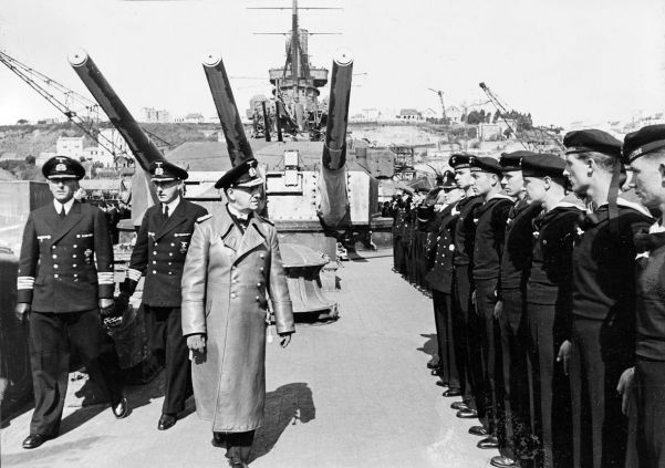 Erich Raeder inspects men of his newly titled Kriegsmarine. The building of surface ships and submarines was increased in 1935.