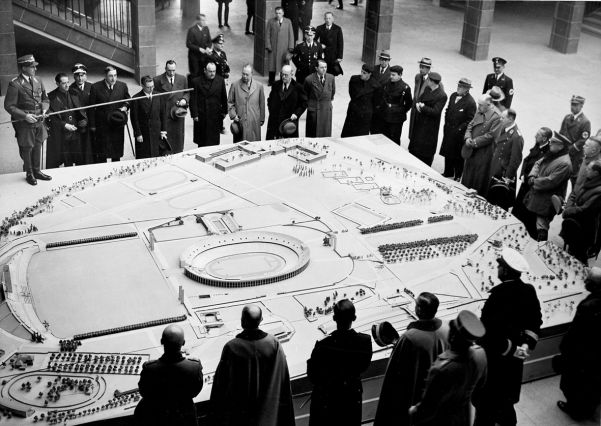A model of the grand Berlin Olympic Stadium, plus the swimming pool, is shown to foreign and German guests.