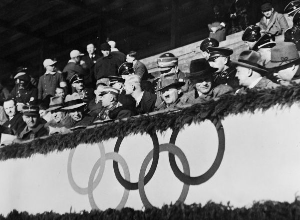 A clearly bored Führer watches an ice hockey game between Great Britain and Hungary at the Olympic Games.