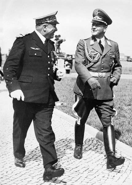 Colonel-General Erhard Milch (right), Luftwaffe commander, laid on a flying display for the Italian dictator.
