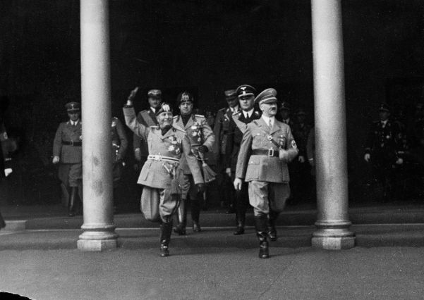 A beaming Mussolini arrives in Germany on September 25 to begin his historic trip to the Third Reich.
