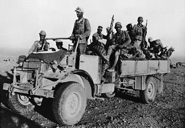 Desert fighters from Germany's Afrika Korps make use of a captured truck during Rommel's second offensive against the British Army