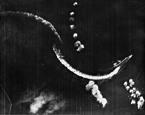 An aerial photograph of the Japanese carrier Hiryu during the Battle of Midway. The ship was set ablaze by a US air attack and subsequently scuttled