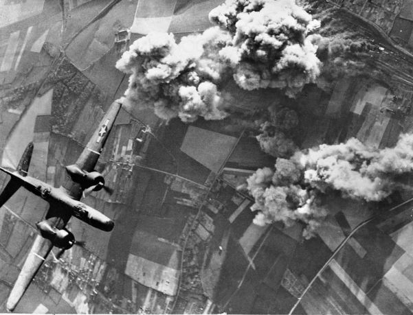 A US A-20 bomber hits an important rail junction at Busigny in northern France
