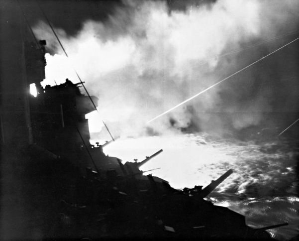 The US Navy bombards the island of Iwo Jima to soften up the defenses prior to an amphibious landing