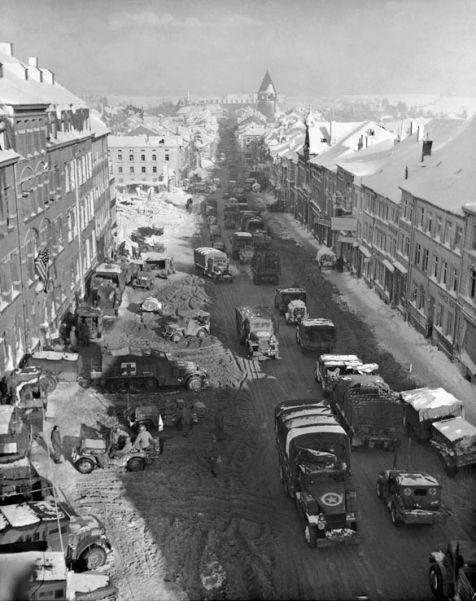 US troops and vehicles in Bastogne, which resisted all German assaults in December 1944 and January 1945