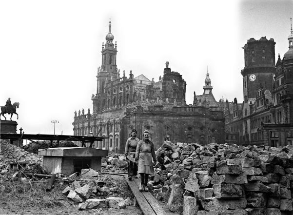 Women help clear rubble from the ruins of the Catholic cathedral in Dresden