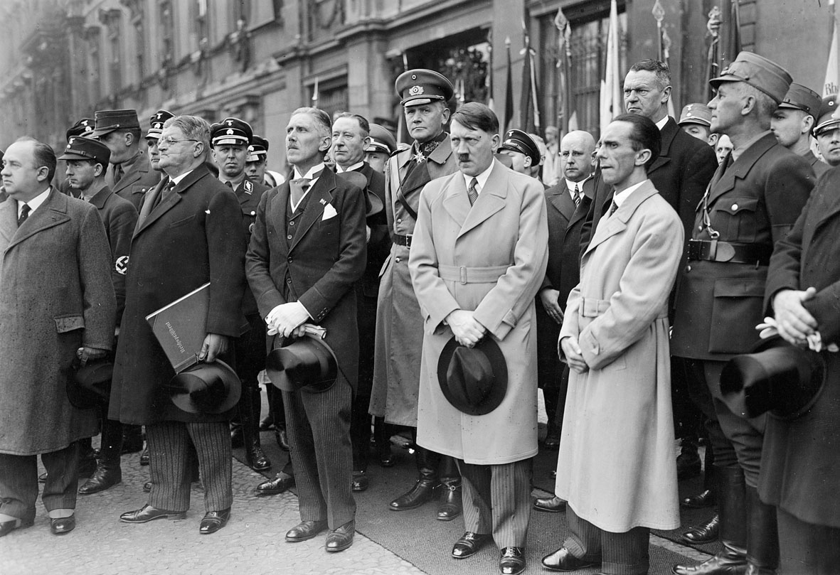 Hitler, Germany's new chancellor, photographed in Berlin in March 1933. To  his right stands Papen, to his left, Goebbels.