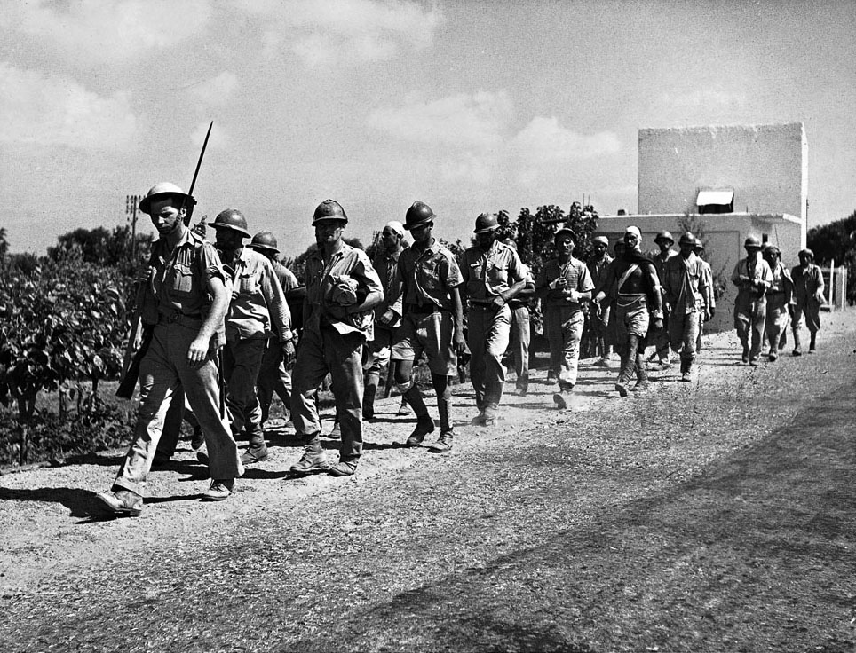 Vichy soldiers are marched into captivity after the surrender of Syria